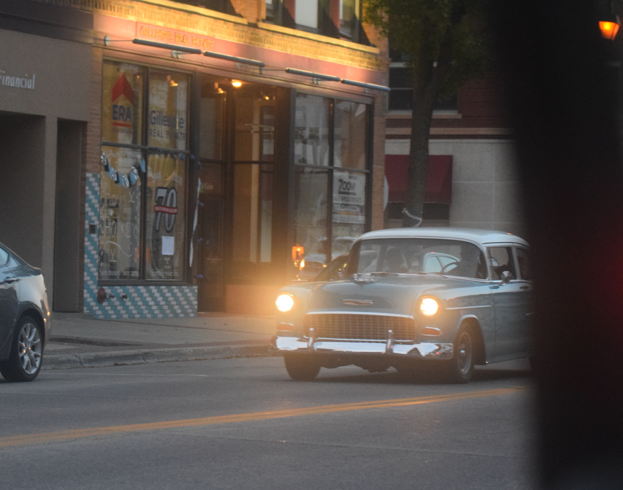Old fashion, restored car driving in downtown Owatonna