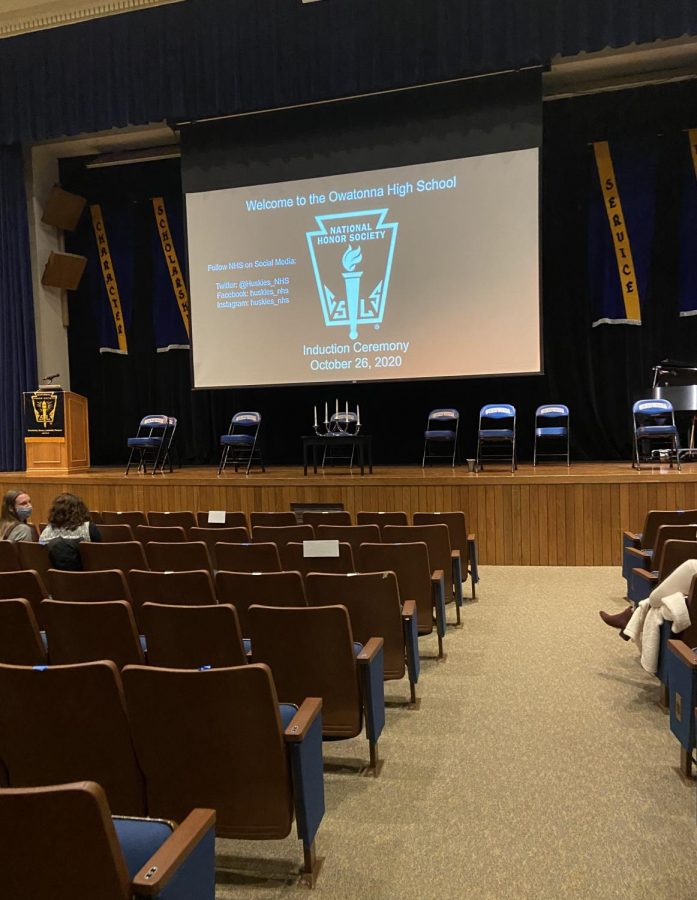 The set-up for the NHS induction ceremonies that includes chairs for the 2020-2021 officers, the candlesticks for the candle ceremony, and a podium for speakers