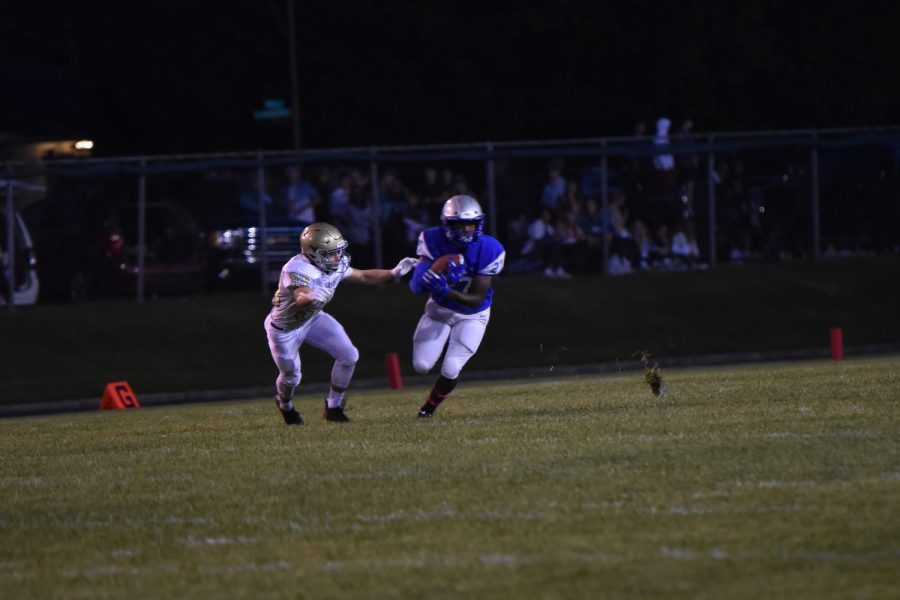 Running back Tanner Hall runs the ball for the Huskies