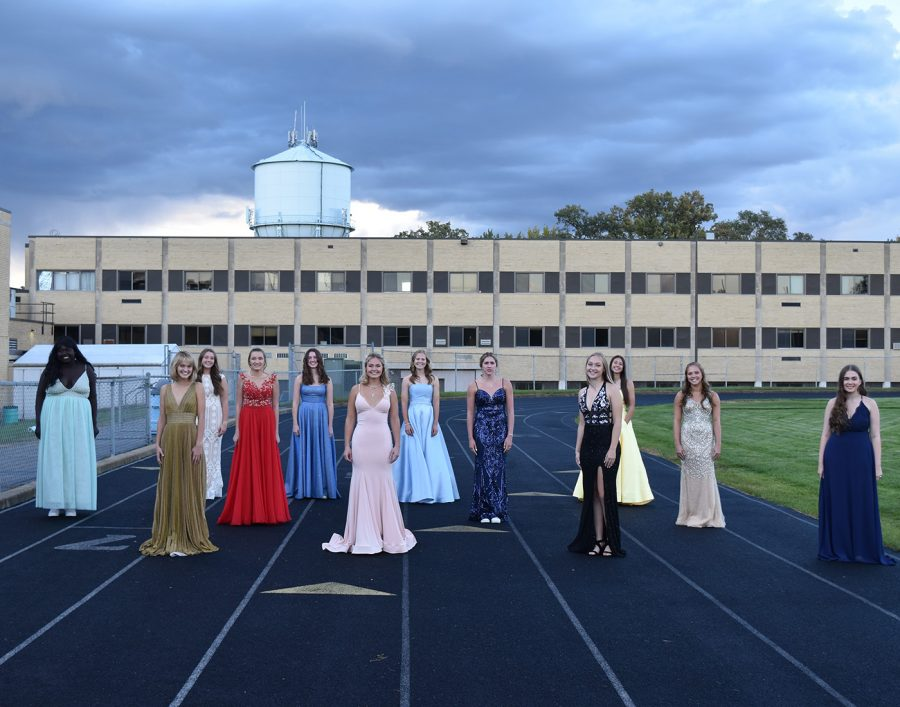 Top 12 homecoming royalty posing for a picture before king and queen were announced