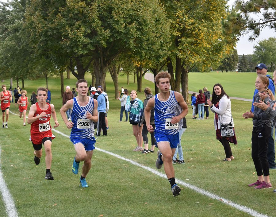 Jake Seykora and Travis Johnson running through the crowd
