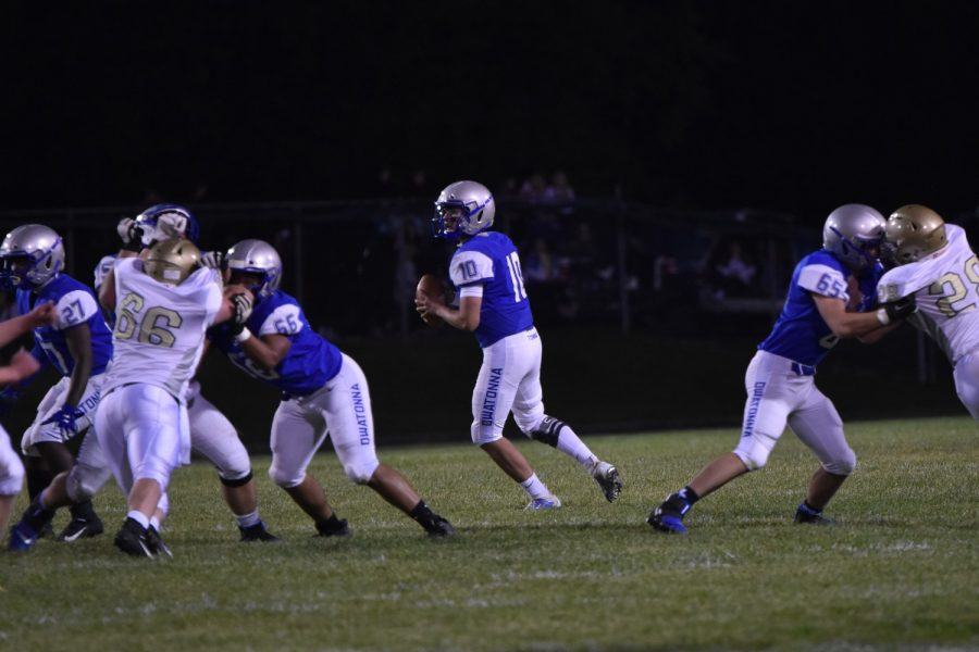 Braydon Truelson prepares to pass the ball in attempts  to gain yardage.