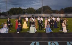 Homecoming court pose for a group photo