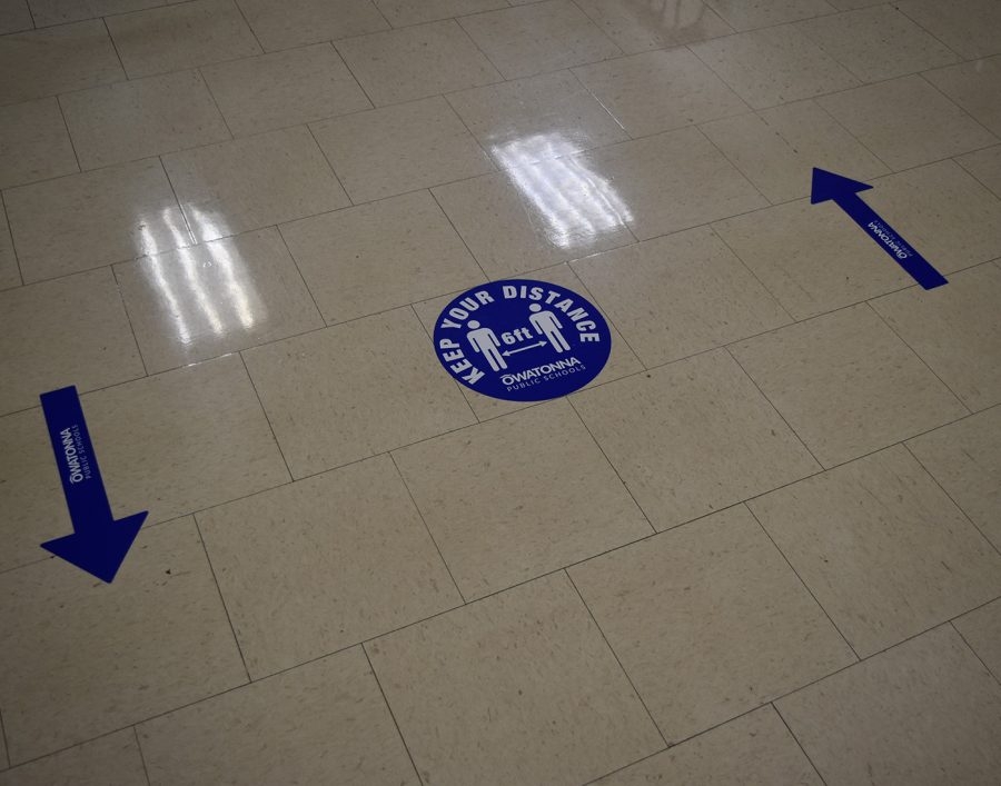 Hallway markers intended to direct student traffic for social distance purposes