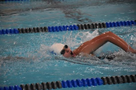 Freshman, Shelby Born swimming the 500 free