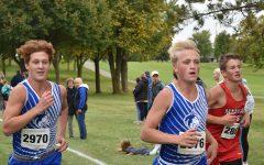 Jacob Reinardy and Sam Snitker overtake Mankato West runner