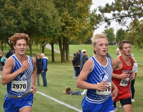 Jacob Reinardy and Sam Snitker overtake Mankato West runner