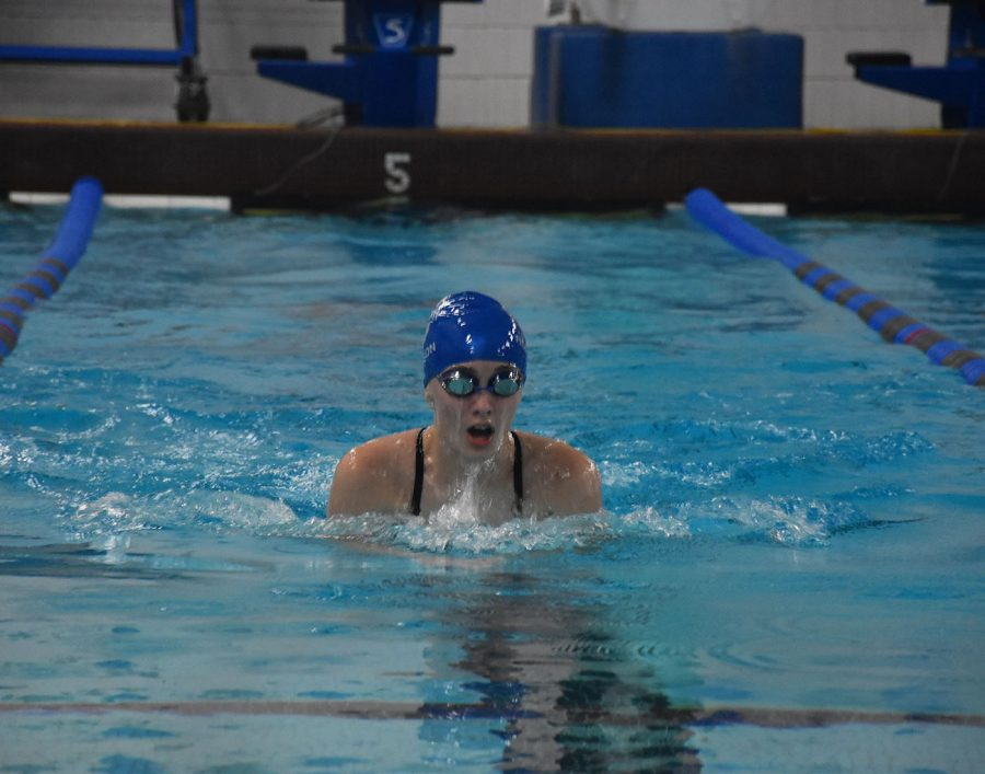 Nora Thompson participates in the breaststroke race