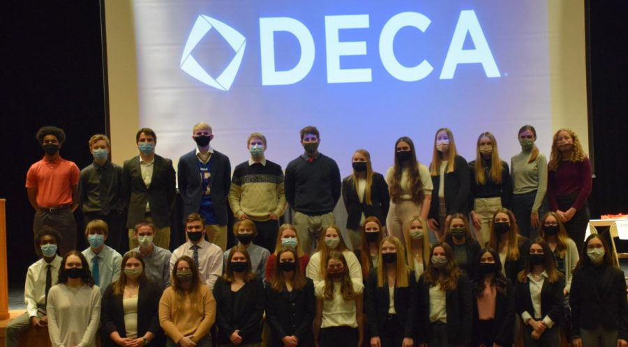 DECA+gathered+for+their+annual+awards+on+Jan.+24.+All+52+members+qualified+for+state.
