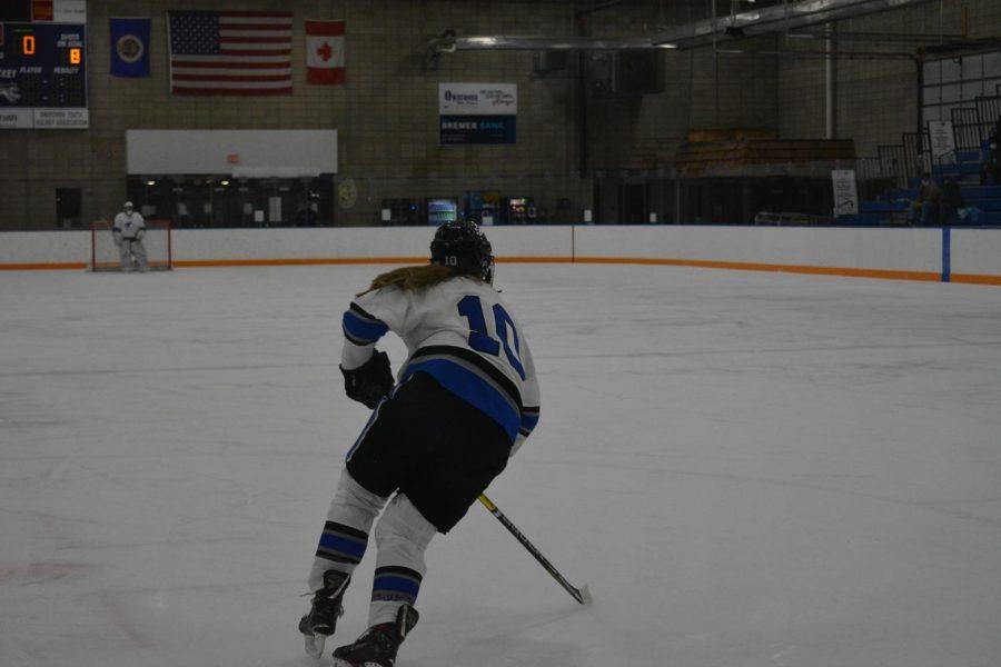 Grace Wolfe skates back to get on defense