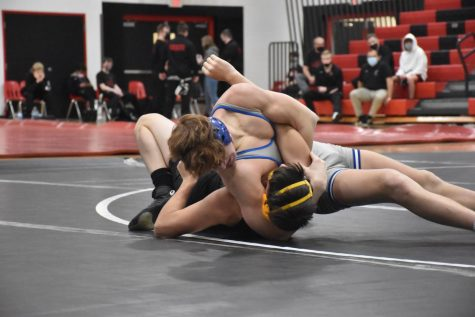 Jacob Reinardy headlocks his opponent