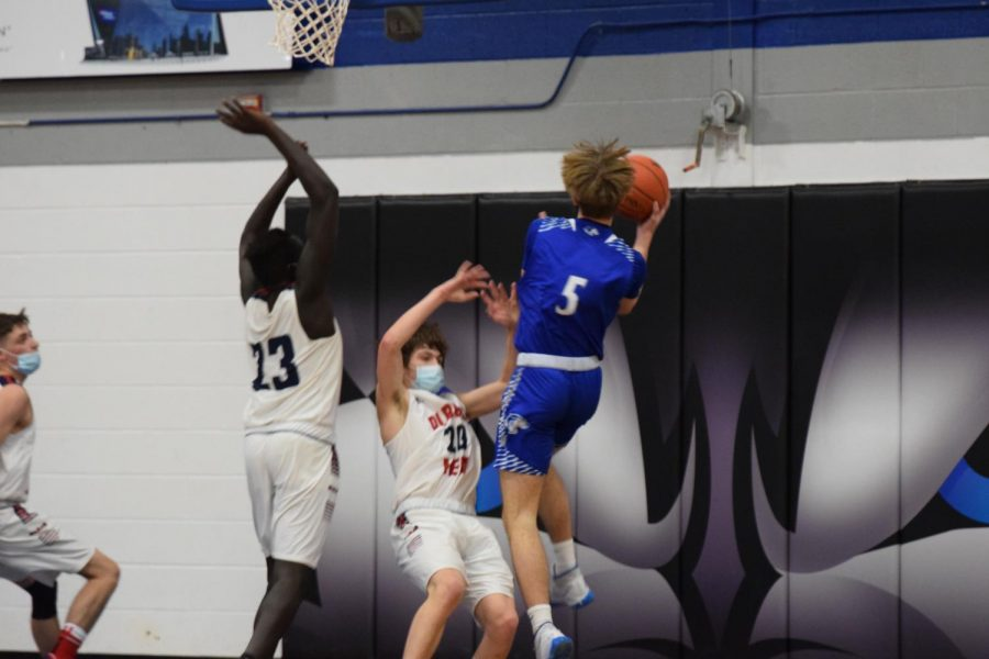 Jack Titchenal soars through the air for the lay-up