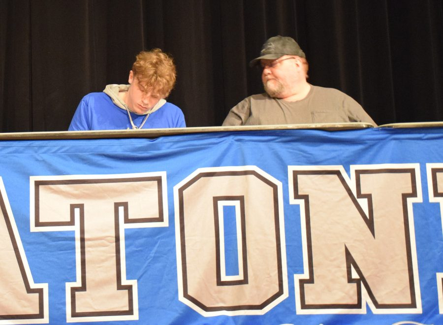 Cole Earles signs to play Division III football at The College of St. Scholastica