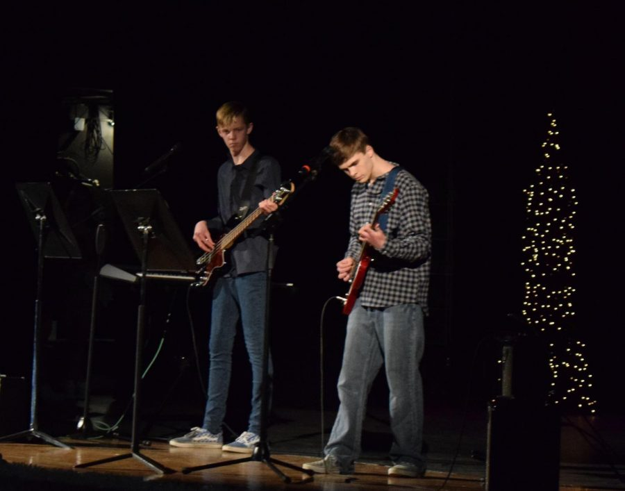 Hunter Johnson (left) and Gavin Karow (right) play a song for their talent