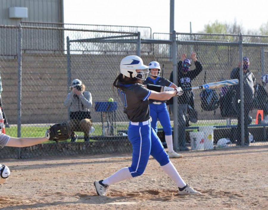 Ana Laduke makes contact with the ball.