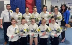 The varsity gymnastics team after winning the section meet.