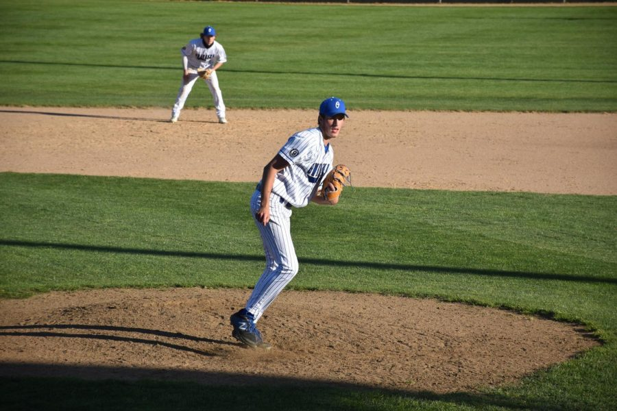 Addison Andrix pitching for the Huskies