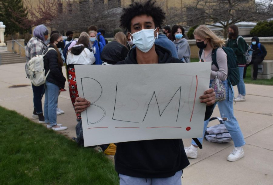 Senior Hamza Ahmed displays his sign that he brought to the walk out