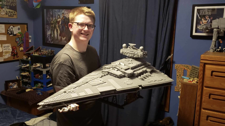 Parker Erickson poses with his largest set, a 4,000+ piece Star Destroyer.