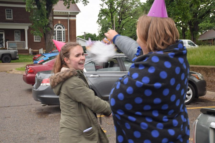 Senior Alix Bettin celebrates her birthday at tailgating