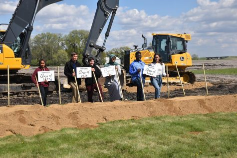 Representatives from the first four classes that will be attending the new high school, get ready to dig at the groundbreaking ceremony.