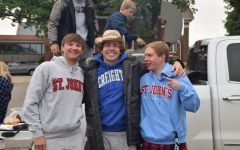 Brayden Truelson, Jonny Wall, and Nolan Burmeister pose for a picture