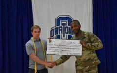 Nolan Burmeister receives his scholarship check