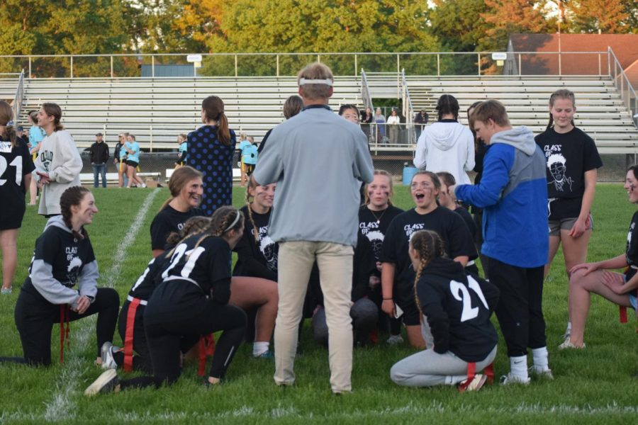 Seniors huddle with coach Lincoln Maher to come up with a game plan