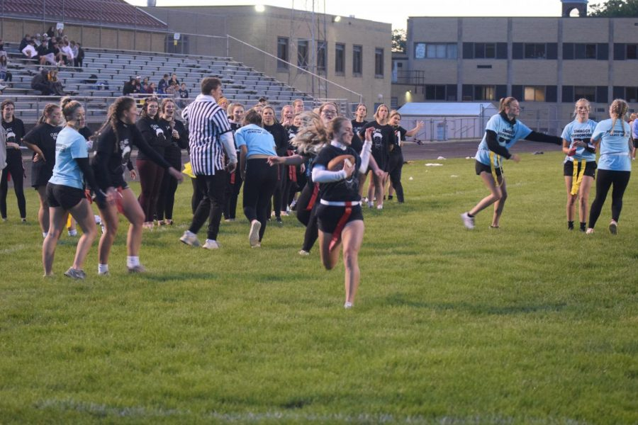Senior Madi Bruessel runs with the ball with the intent to score a touchdown