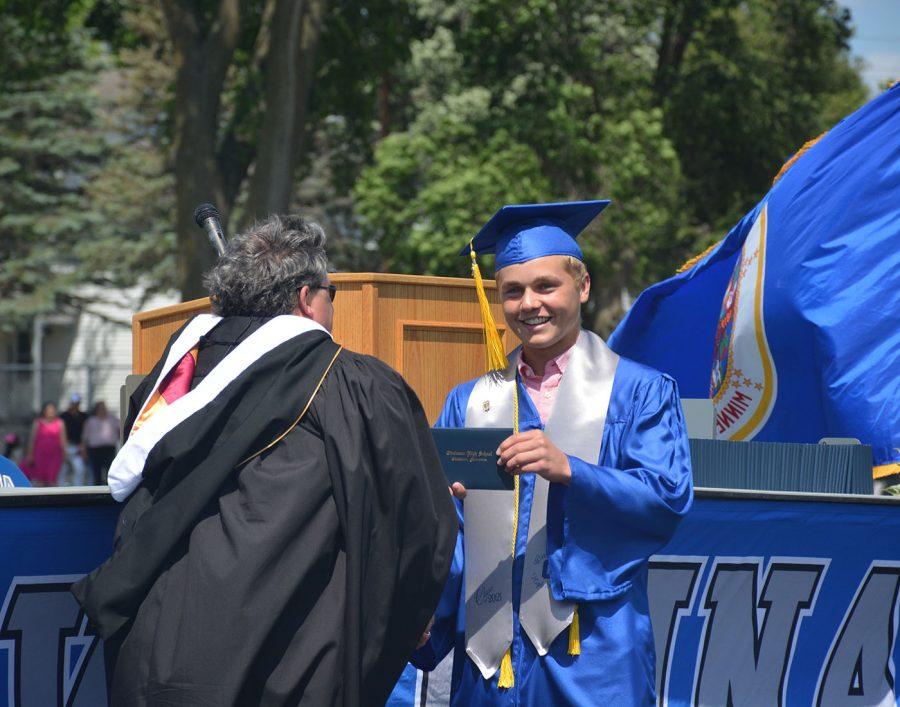 Caleb Schuler accepting his diploma at graduation