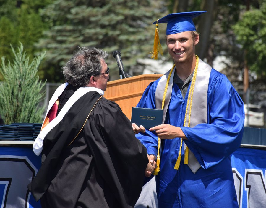 Lincoln Maher accepts his diploma from School Board Member Tim Jensen