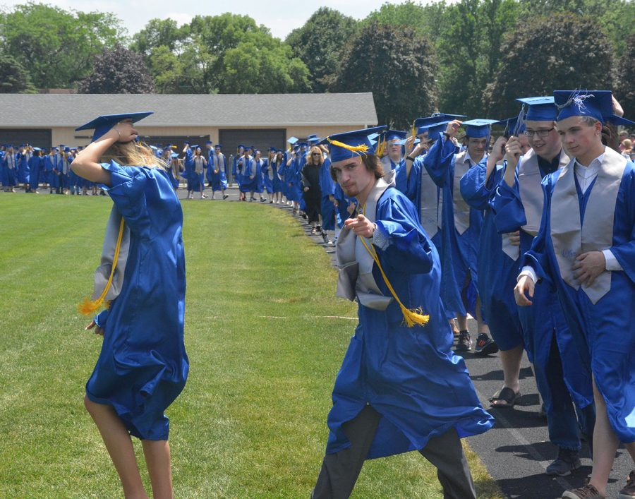 Oliver Hansen walking out to commencement