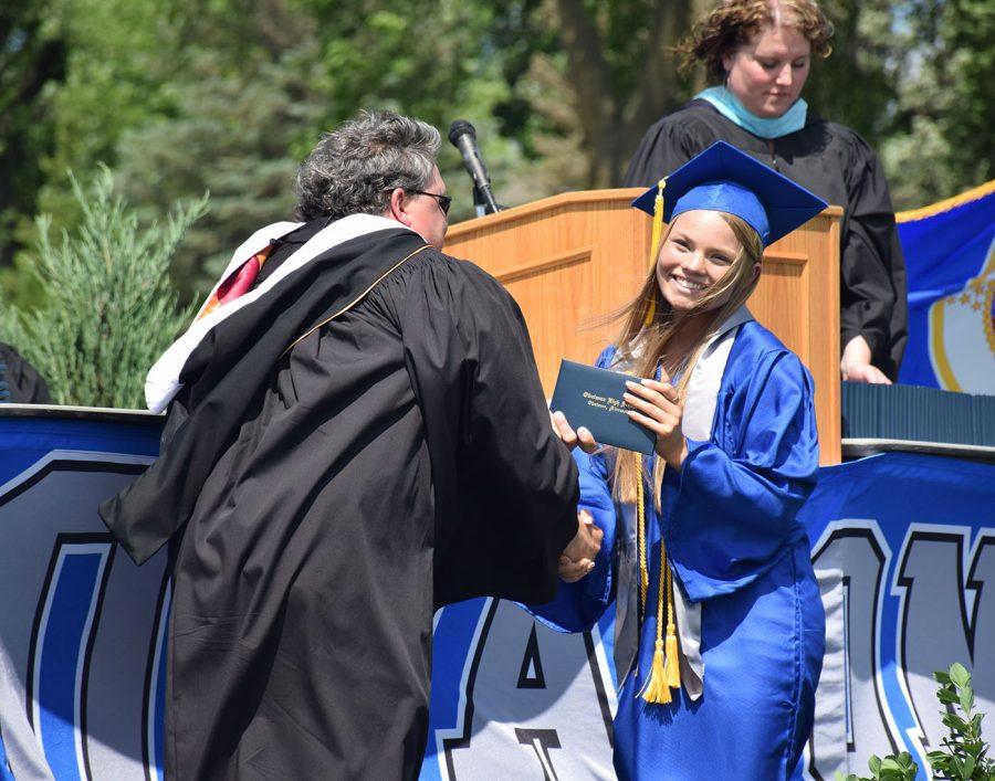 Lexi Ringhofer receiving her diploma