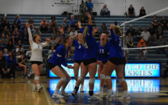 Owatonna volleyball team celebrates after winning the point