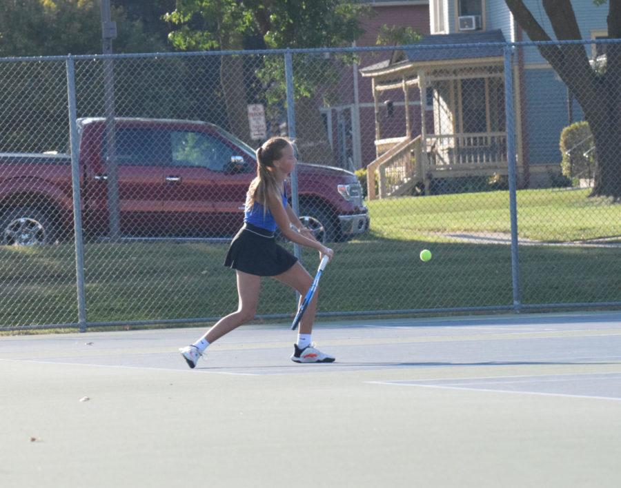 Olivia Mcdermott using her forehand to return the ball