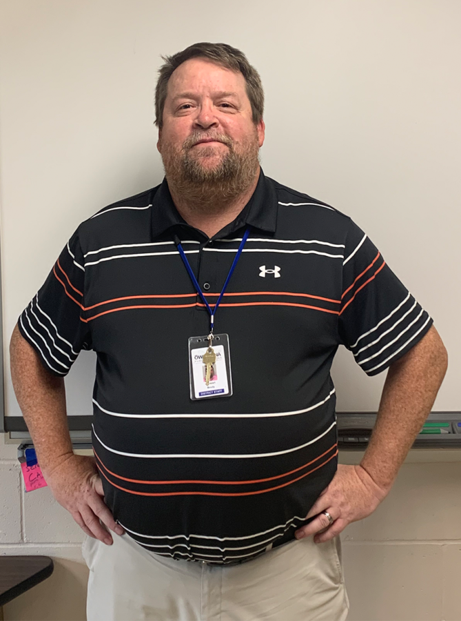 Mr. Stewart Brody, a new science teacher at OHS, standing at the front of his classroom.