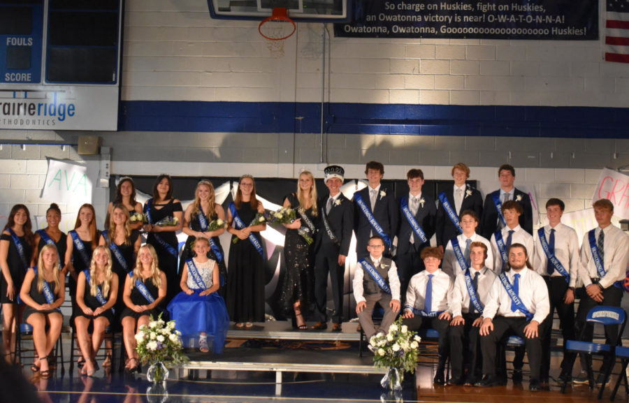 OHS Homecoming King and Queen Dylan Meiners and Jenna Dallenbach  pose with Top 12 nominees and junior royalty.